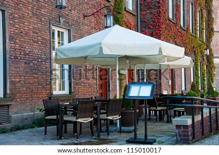 cafe on the street near the old building - stock photo