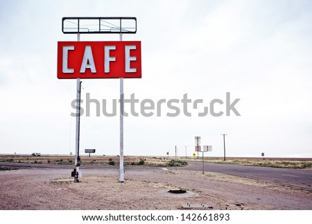 Cafe sign along historic Route 66 in Texas. Vintage Processing. - stock photo