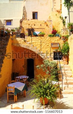 cafe taverna restaurant setting in greek islands - Santorini - stock photo