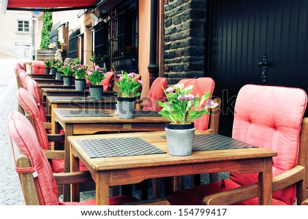 Cafe terrace in small European city - stock photo