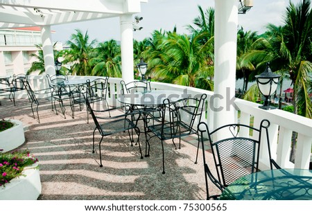 cafe terrace with Iron patio furniture - stock photo