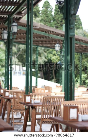 Cafe with wooden tables - stock photo