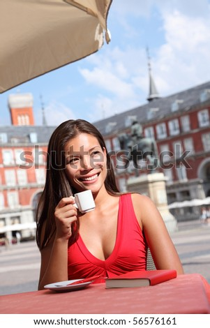 Cafe woman - Madrid tourist drinking coffee on Plaza Mayor, Madrid, Spain - stock photo