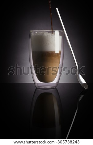 Caffe latte on dark background. Culinary coffee drinking. - stock photo