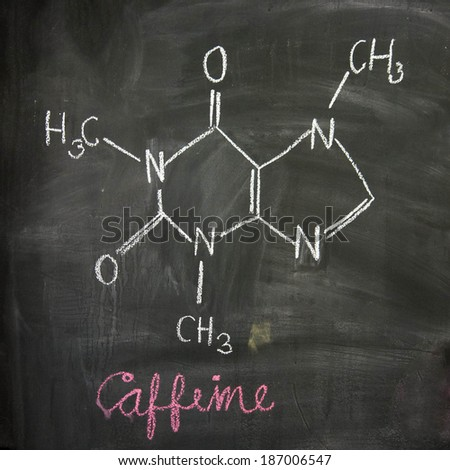 Caffeine chemical molecule structure on blackboard. Caffeine molecule drawing on chalkboard as it is found in coffee and tea etc - stock photo