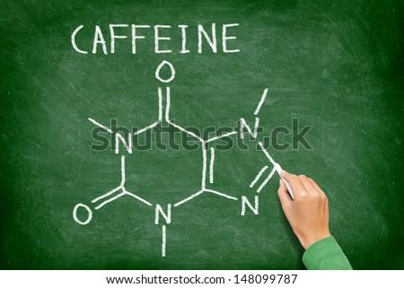 Caffeine molecule blackboard. chemical molecule structure on chalkboard. Caffeine molecule drawing on chalkboard as it is found in coffee and tea etc. - stock photo