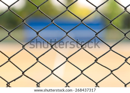cage of blurred tennis court - stock photo