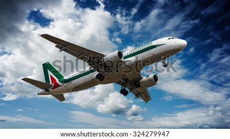 Cagliari - 4/10/2015 : Airbus A320 Alitalia landing on Cagliari Elmas Airport on runway 14 - stock photo