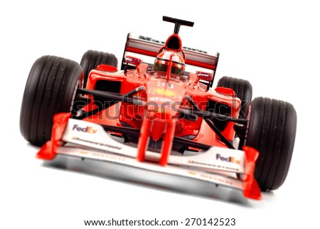 "Cagliari, Italy - 16 April 2015: A model of the Ferrari Formula 1 car ""F2000"" drived by Michael Shumacher - Front view static - focus is on the pilot helmet - stock photo"