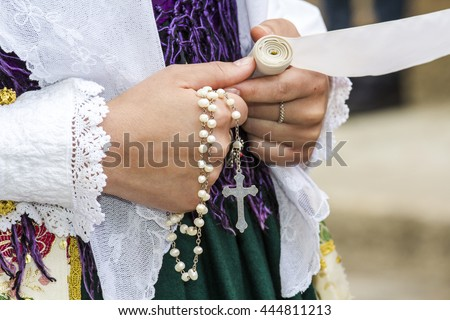CAGLIARI, ITALY - May 1, 2016: 360 Sant'Efisio Festival - Sardinia - particularly of the hands of a girl in traditional Sardinian costumes - stock photo