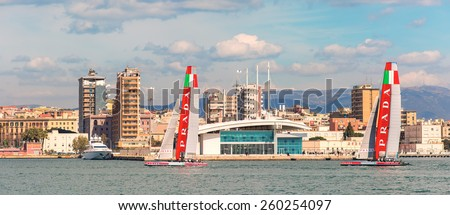 Cagliari - 10 March 2015 : America's Cup Luna Rossa catamaran sails for training session in the Gulf of Cagliari,no special event, no credit or release needed. In the background the cruise terminal. - stock photo