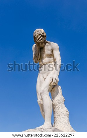 Cain coming from having killed his brother Abel. Statue in Tuileries park. Paris, France - stock photo
