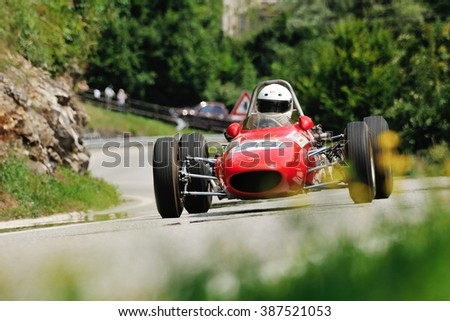 CAINO (BS), ITALY - JUNE 27: A red Branca Formula junior car takes part to the Nave Caino Sant'Eusebio race on June 27, 2015 in Caino (BS). The car was built in 1962. - stock photo