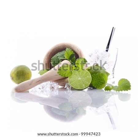 Caipirinha Ingredients with mortar and pestle and fresh lime. Aside an empty glass with ice cubes. For Drinkable Concepts - stock photo