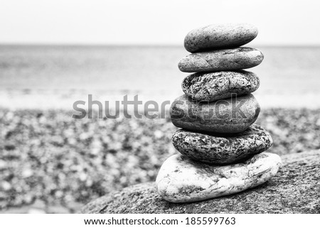 Cairn, black and white photo from a beach in Schleswig-Holstein, Germany - stock photo