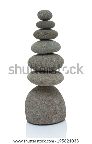 Cairn, trail marker, stacking stones on white - stock photo