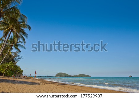 Cairns - A beautiful tropical beach with palm trees at sunrise in northern Australia  - stock photo