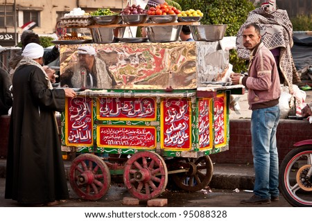 CAIRO - DECEMBER 5:  Food stall in Tahrir Square, Cairo during the anti government protest and demonstration, on 5 December 2011 in Cairo. - stock photo