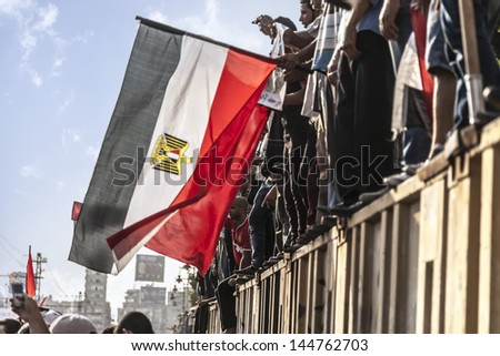 "CAIRO, EGYPT - JULY 1: Egyptian protesting in El-Etehadeya district during ""June 30"" protests against Mohamed Morsy. Cairo - July 1, 2013 - stock photo"