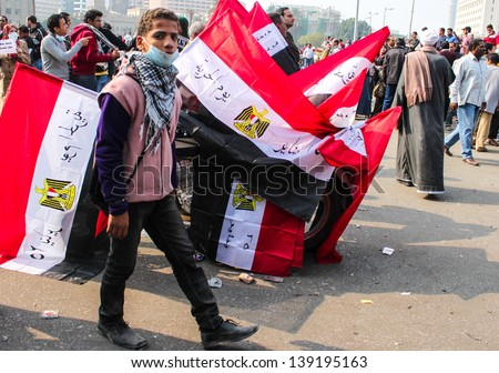 CAIRO, EGYPT - NOV 22-Thousands of protesters flocked to Cairo's Tahrir Square, Egypt, Nov 22, 2011. People were dead and injured because of tear gas, rubber bullets of riot police. - stock photo