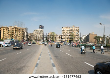 CAIRO - MAY 8: The famous Tahrir square on May 8, 2013 in Cairo, Egypt. Tahrir square -  thousands of protesters made Egyptian uprising in January 2011. - stock photo