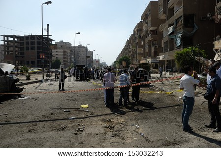 CAIRO - SEP 05: CID, police and prosecution at the site after the explosion that was targeting the Interior Minister in Mostafa el-Nahas st. in Nasr City, Cairo, Egypt on September 05, 2013 - stock photo