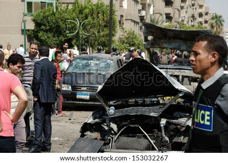 CAIRO - SEP 05: Members of CID, prosecution, police secure area and search for evidences in site area after the explosion that was targeting the interior minister. Cairo, Egypt on September 05, 2013 - stock photo