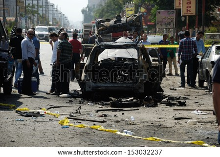 CAIRO - SEP 05: One of the exploded cars belongs to the interior minister's convoy after the explosion that was targeting the Interior Minister in Mostafa Nahas st.Cairo, Egypt on September 05, 2013 - stock photo