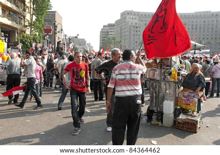 "CAIRO - SEPTEMBER 9: Crowds of Egyptians converged on Cairo's Tahrir Square on Friday to demand reforms in a turnout dubbed ""correcting the path of the revolution"".  Cairo, September 9, 2011 - stock photo"