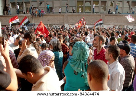 "CAIRO - SEPTEMBER 9: Crowds of Egyptians near AUC buildings on Friday to demand reforms in a turnout dubbed ""correcting the path of the revolution"".  Cairo, September 9, 2011 - stock photo"