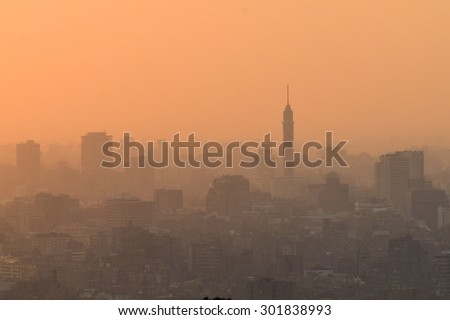 Cairo skyline at sunset with dense haze - Egypt - stock photo