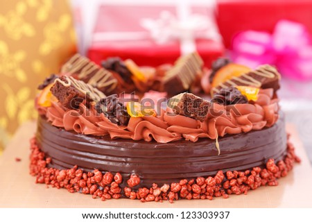 Cake and gift boxes in background - stock photo