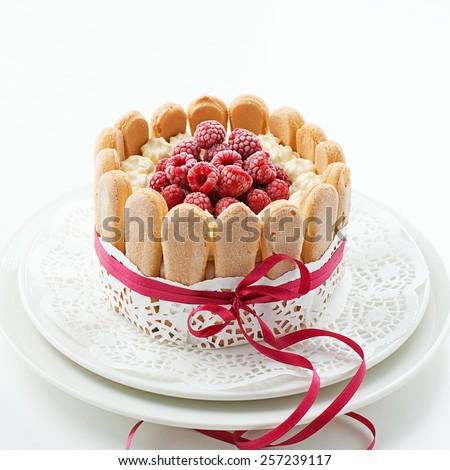 "Cake ""Charlotte "" with raspberries and cream. - stock photo"