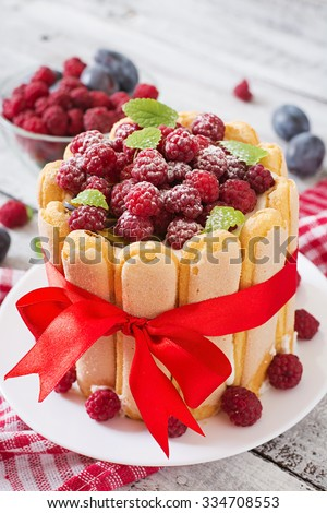 "Cake ""Charlotte "" with raspberries and plums. - stock photo"