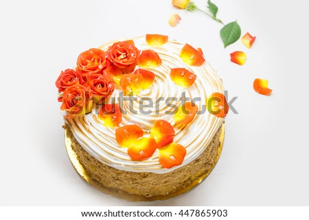 Cake decorated with red roses and rose petals - stock photo