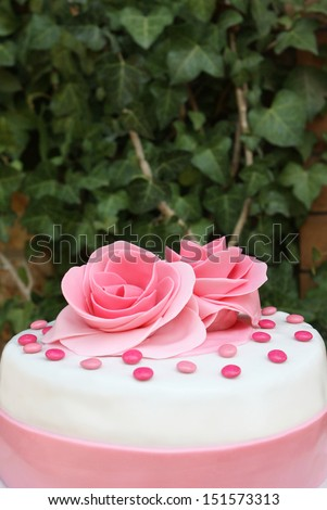 Cake design with roses - stock photo
