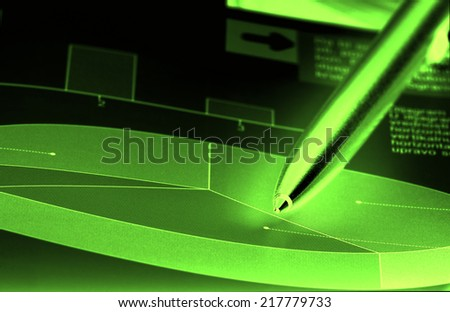Cake diagram with pencil pointing in neon light on dark background - stock photo