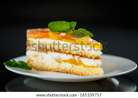 cake filled with fruit on a black background - stock photo