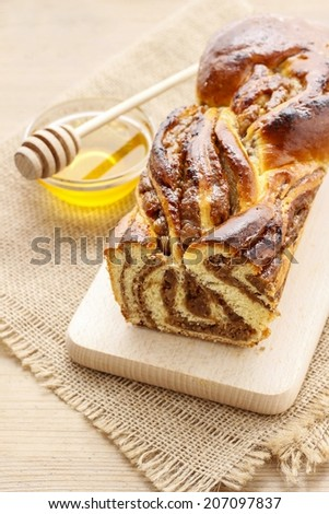 Cake filled with poppy seed and jam - stock photo
