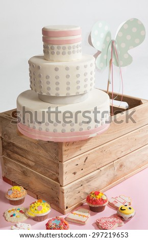 cake for baptism with other candies - stock photo