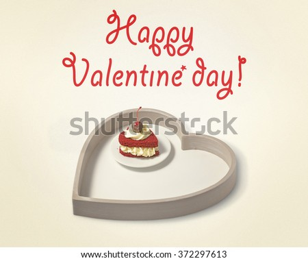 cake in the shape of a heart on a tray in the shape of a heart (postcard in retro style) - stock photo