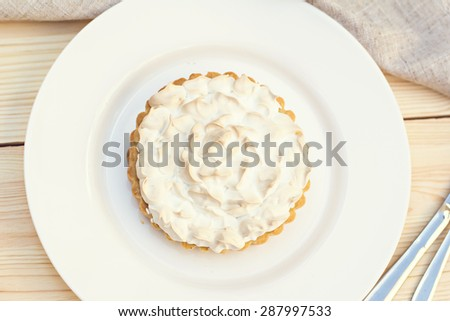 Cake or Lemon pie with meringue. Tonned photo - stock photo