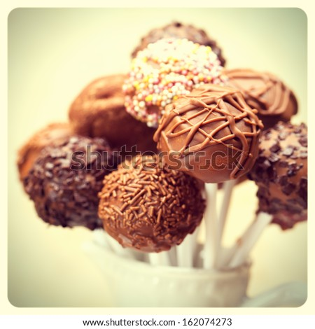 Cake pops with retro filter effect and border. Vintage style old-fashioned photo - stock photo