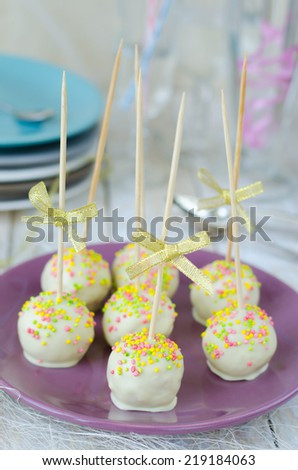 Cake pops with white chocolate and sprinkles vertical  - stock photo