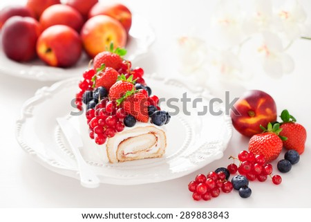 Cake roll with fresh berries, selective focus - stock photo