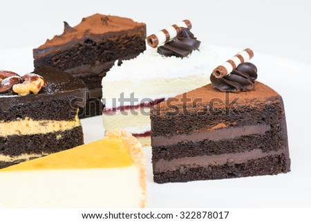 Cake slices on a plate - stock photo