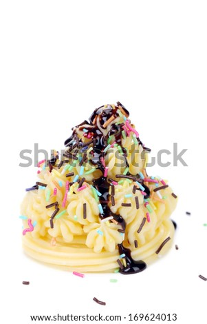 Cake topped with melted chocolate. Isolated on a white background. - stock photo