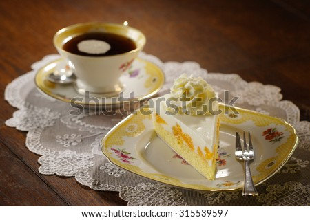 cake with cream and tangerines - stock photo