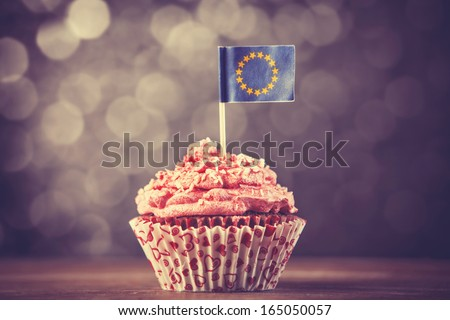 Cake with EU flag. Photo in vintage color style - stock photo