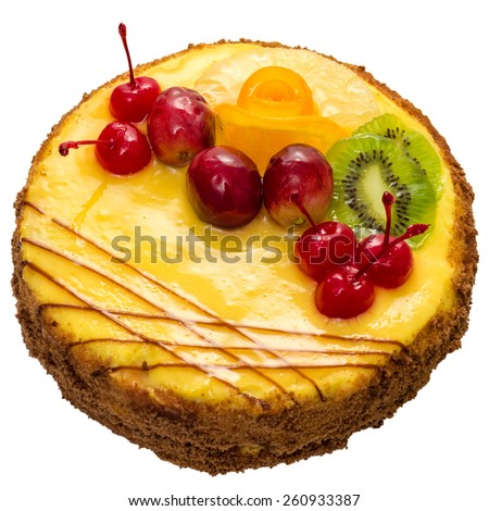 Cake with fruits isolated on white, angle view. - stock photo